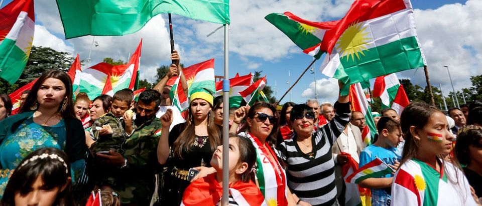 People attend a demonstration in support of the referendum for independence of Kurdish Iraq in front of the Palais des Nations in Geneva, Switzerland September 10, 2017. REUTERS/Pierre Albouy