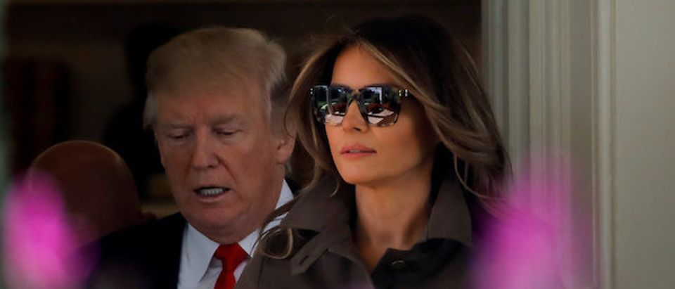 U.S. President Donald Trump and first lady Melania Trump leave the Oval Office of the White House during their departure for Bedminster, New Jersey, in Washington