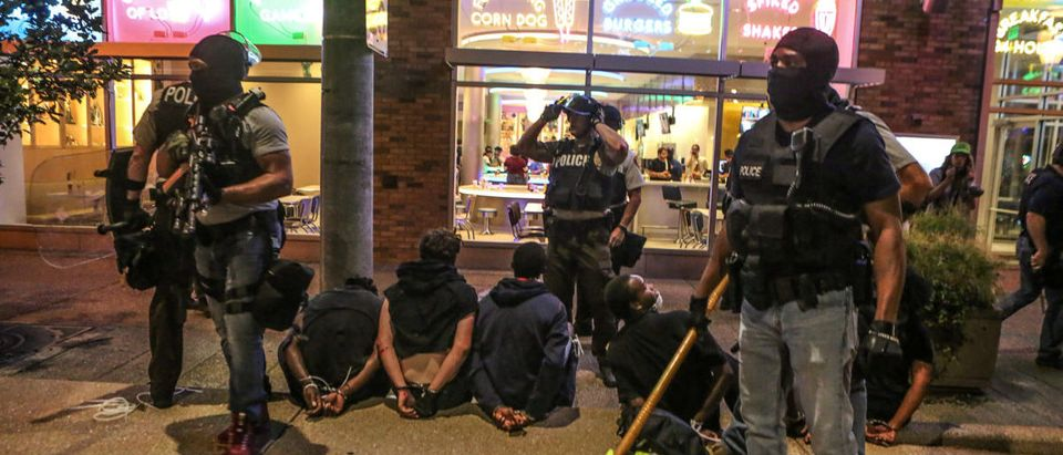 Police detain protesters arrested for causing damage to local businesses during the second night of demonstrations after a not guilty verdict in the murder trial of former St. Louis police officer Jason Stockley, charged with the 2011 shooting of Anthony Lamar Smith, who was black, in St. Louis, Missouri, U.S., September 16, 2017. Photo taken September 16, 2017. REUTERS/Lawrence Bryant