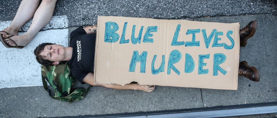 """A protester participates in a """"Die-In"""" during a second day of demonstrations after a not guilty verdict in the murder trial of former St. Louis police officer Jason Stockley, charged with the 2011 shooting of Anthony Lamar Smith, who was black, in St. Louis, Missouri, U.S., September 16, 2017. Photo taken September 16, 2017. REUTERS/Lawrence Bryant"""