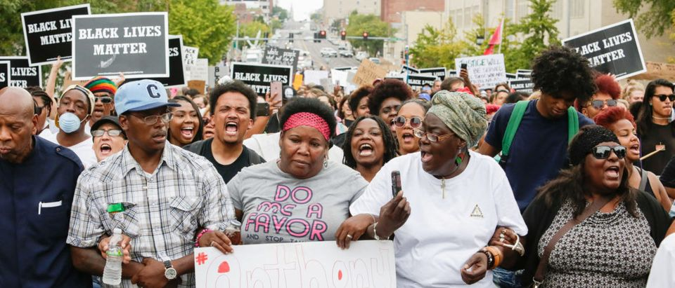 Anthony Lamar Smith's mother, Annie, walks with family and protesters during a peaceful rally after the not guilty verdict in the murder trial of Jason Stockley, a former St. Louis police officer charged with the 2011 shooting of Smith, in St. Louis, Missouri, U.S. September 17, 2017. Picture taken September 17, 2017. REUTERS/Lawrence Bryant