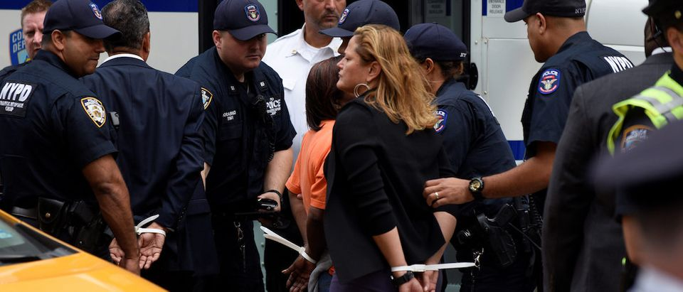 Melissa Mark-Viverito is arrested during a rally with immigrant New Yorkers during a march to Trump Tower to demand that U.S. President Donald Trump works with Congress to pass a clean DREAM Act in New York