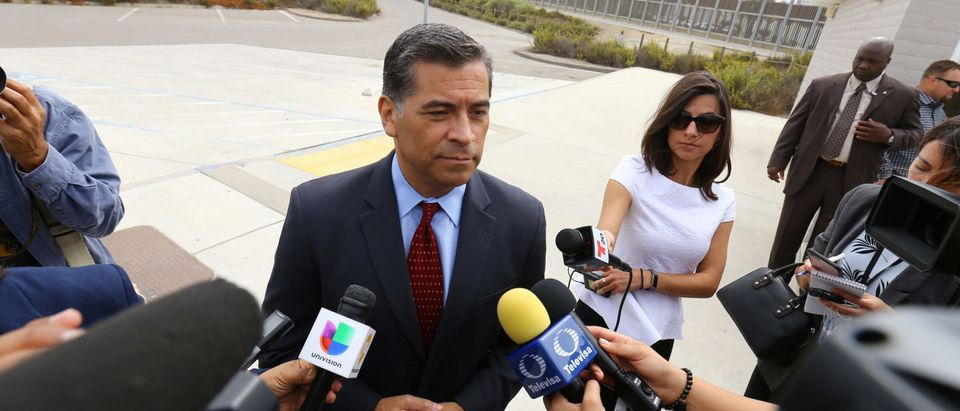 Attorney General of California Xavier Becerra speaks to the media at the U.S.-Mexico border at the Pacific Ocean after announcing a lawsuit against the Trump Administration
