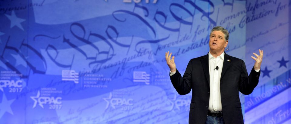 Conservative TV and radio personality Sean Hannity gestures during remarks during the opening day of the Conservative Political Action Conference (CPAC), an annual gathering of conservative politicians, journalists and celebrities at National Harbor, Maryland, U.S., February 22, 2017. REUTERS/Mike Theiler