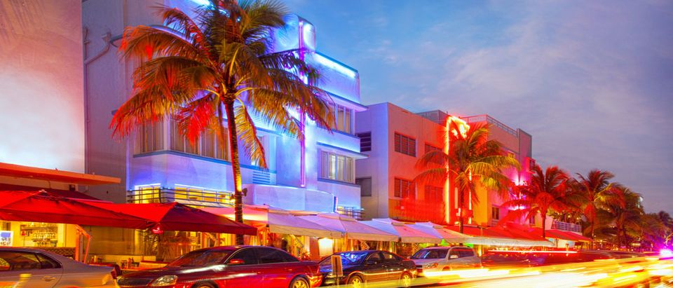 Miami Beach, Florida illuminated hotels and restaurants at sunset on Ocean Drive, world famous destination for nightlife, beautiful weather and pristine beaches (Shutterstock/fotomak)