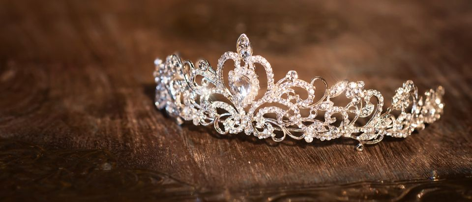 Shutterstock/ Wedding crown tiara diadem. Luxury accessories crowntiaraaccessorybackgroundbeautifulbeautyblackbridebrilliantcontestcoronacrystaldecorationdesigndiademdiamondelegancefairyfashionfemalejewelryluxurymissobjectpageantpartyprincessqueenreflectionshinyweddingwhitewoodenShow more