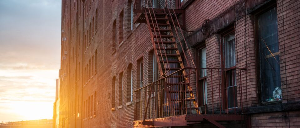 Fire Escape stairs on the building wall in New York City Shutterstock/ Nick Starichenko