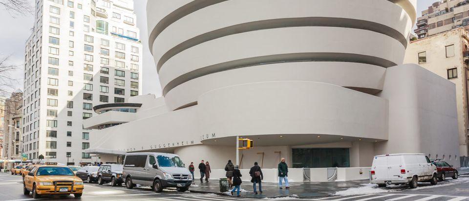 NEW YORK - JANUARY 11,2009 : The Solomon R. Guggenheim Museum of modern and contemporary art. Designed by Frank Lloyd Wright on January 11, 2009 in New York City, USA guggenheimmuseumnewyorksolomonstreetwallwinteramericaartattractionautumnbluebuildingcarcitycityscapeconcretecontemporarydayentranceexcursionexhibitionfacadefrontlandmarkmanhattanmilemodernnyoutdoorpublicr.roadsiteskystyletouristtowntrafficurbanusaviewvisit(Shutterstock)
