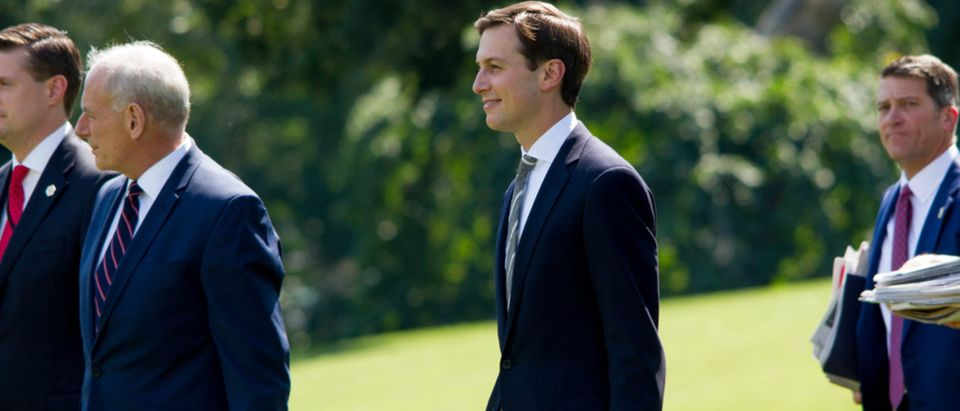 White House aide and Donald Trump's son-in-law, Jared Kushner (center), walks on to the South Lawn of the White House to board Marine One, Friday, August 4, 2017. kushnertrumpair force onedonald trumpgophelicopterjared kushnerjohn kellymarine onemarinespoliticsrepublicanrob portersouth lawnstaffvacationwashingtonwashington dcShow more
