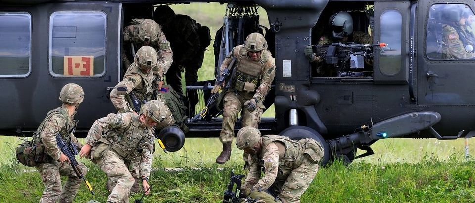 U.S. army soldiers leave Black Hawk helicopter during Suwalki gap defence exercise in Mikyciai