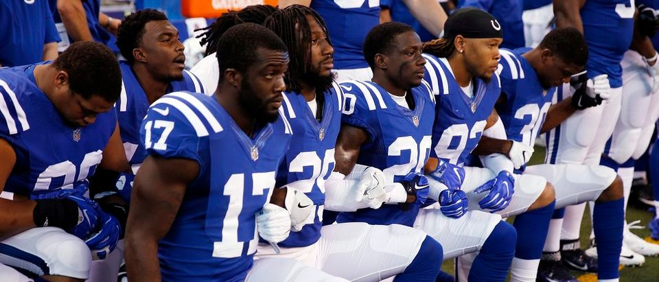 Sep 24, 2017; Indianapolis, IN, USA; Indianapolis Colts players kneel during the playing of the National Anthem before the game against the Cleveland Browns at Lucas Oil Stadium. Brian Spurlock/USA TODAY Sports.