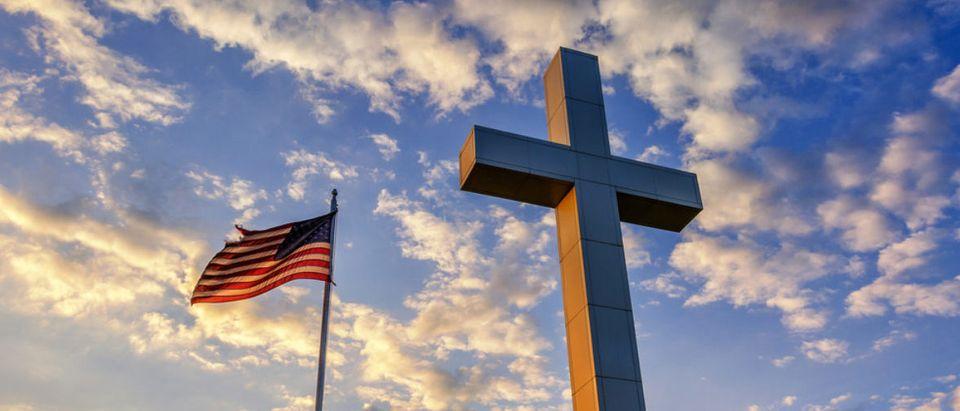 American flag and religious cross at sunset (anthony heflin/shutterstock_357934955)