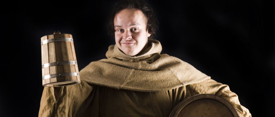 medieval monk with wine barrel (Kachalkina Veronika/shutterstock_64400857)