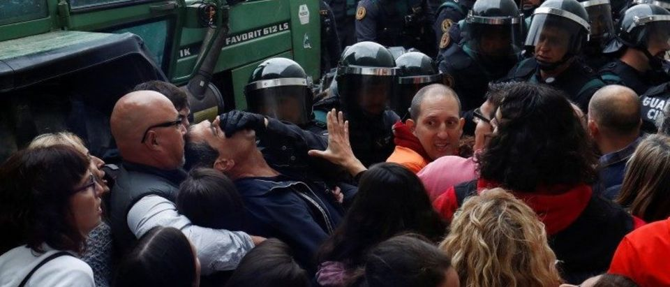 Scuffles break out as officers force their way through crowd and into polling station for Catalonia referendum in Sant Julia de Ramis