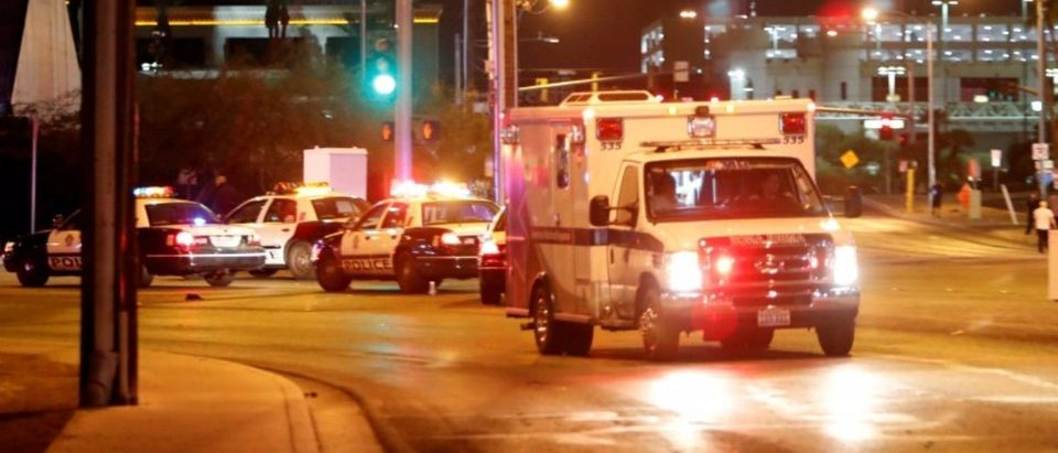 An ambulance leaves the concert venue after a mass shooting at a music festival on the Las Vegas Strip in Las Vegas