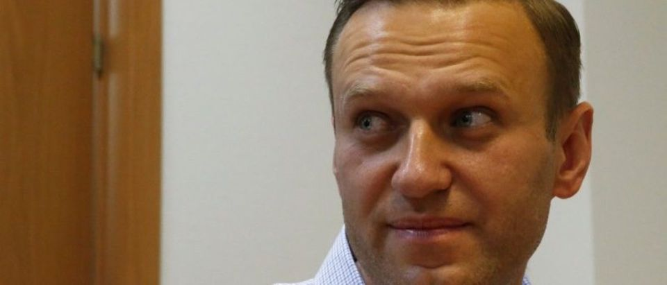 Russian opposition leader Alexei Navalny attends a hearing after he was detained by police as he left his Moscow home on Friday to take part in a pre-election rally in Nizhny Novgorod, at a court in Moscow