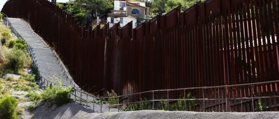 The U.S.-Mexico border fence cuts through Nogales