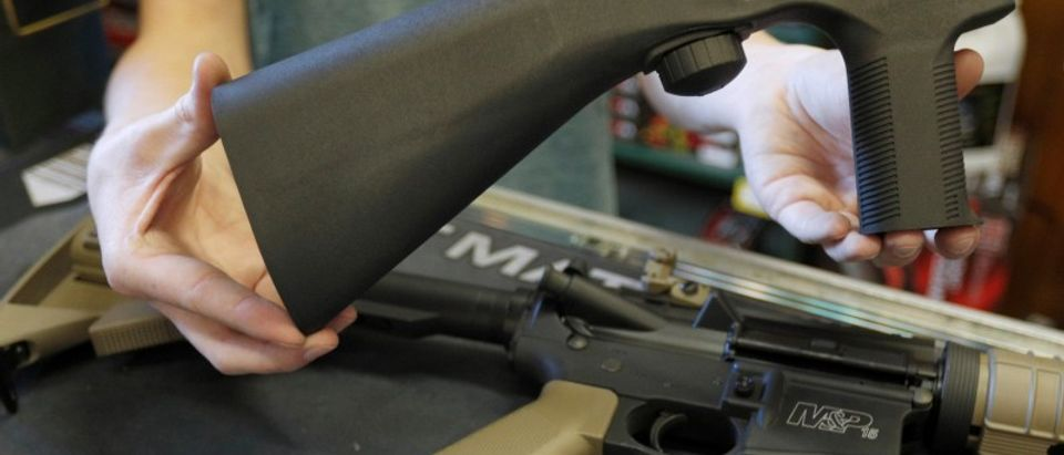 A bump fire stock that attaches to an semi-automatic assault rifle to increase the firing rate is seen at Good Guys Gun Shop in Orem