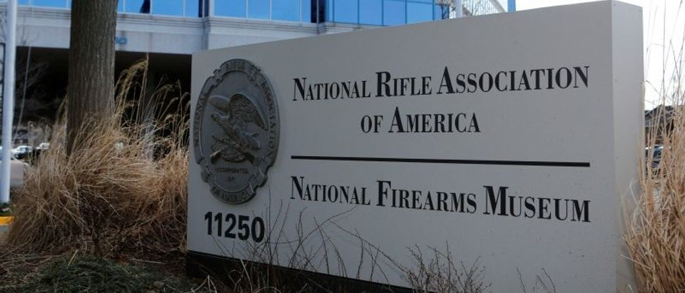 FILE PHOTO: A sign of the National Rifle Association is seen in front of their headquarters in Fairfax, Virginia