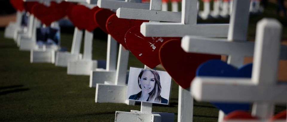 A photograph hangs from one of the 58 white crosses set up for the victims of the Route 91 music festival mass shooting in Las Vegas
