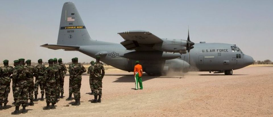 FILE PHOTO: A C-130 U.S. Air Force plane lands as Nigerien soldiers stand in formation during the Flintlock military exercise in Diffa