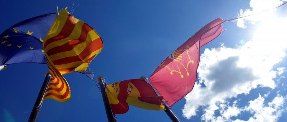 EU, Catalan, Spanish and Aranese flags fly in Vielha, in the Val d'Aran, Catalonia