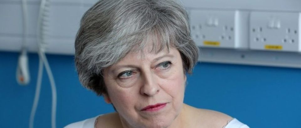 Britain's Prime Minister Theresa May speaks to patients during a round table discussion as they visit the Renal Transplant Unit at the Royal Liverpool University Hospital, Liverpool
