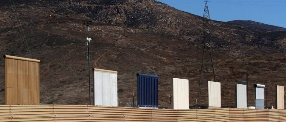 Prototypes for U.S. President Donald Trump's border wall with Mexico are shown near completion behind the current border fence, in this picture taken from the Mexican side of the border, in Tijuana