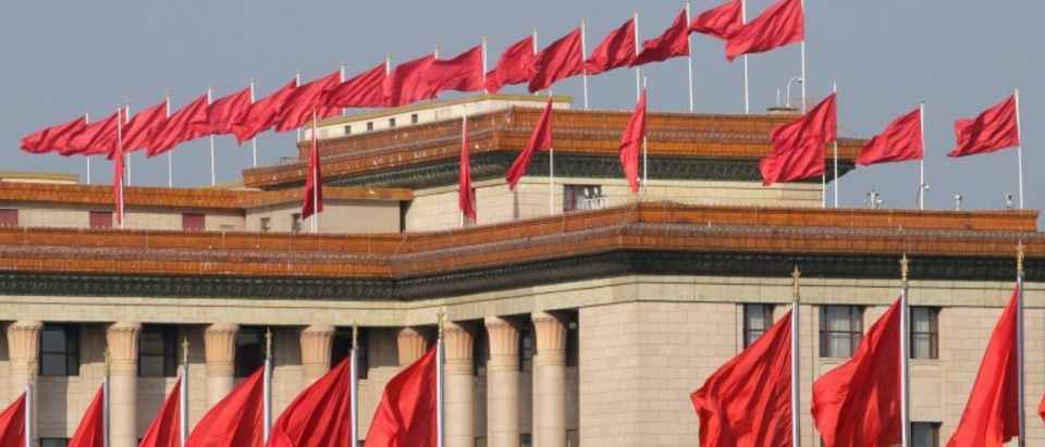 Red flags are seen on the top of the Great Hall of the People in Beijing