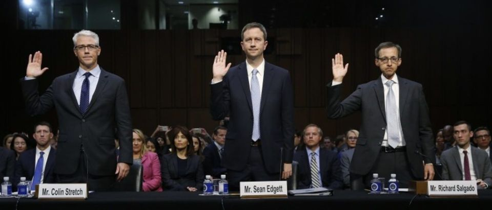 "(L-R) Colin Stretch, general counsel for Facebook; Sean Edgett, acting general counsel for Twitter; and Richard Salgado, director of law enforcement and information security at Google, are sworn in prior to testifying before Senate Judiciary Crime and Terrorism Subcommittee hearing on on ""ways to combat and reduce the amount of Russian propaganda and extremist content online,"" on Capitol Hill in Washington, U.S., October 31, 2017. REUTERS/Jonathan Ernst"