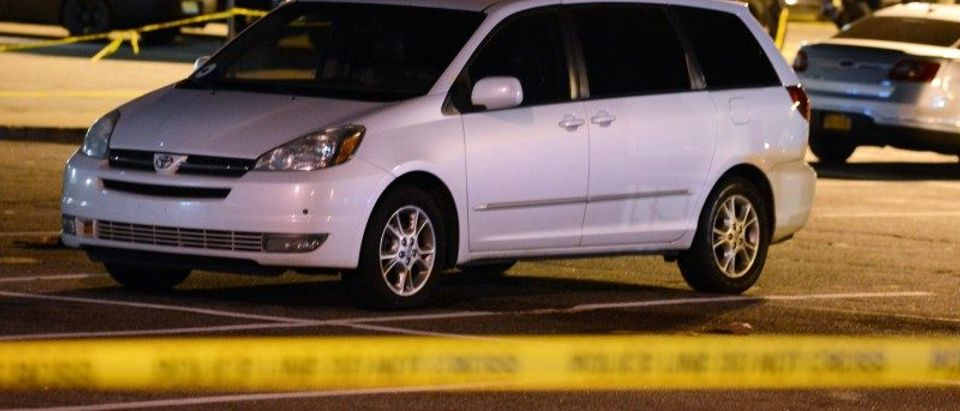 A minivan is taped off by police at a parking lot of a Home Depot in Passaic New Jersey