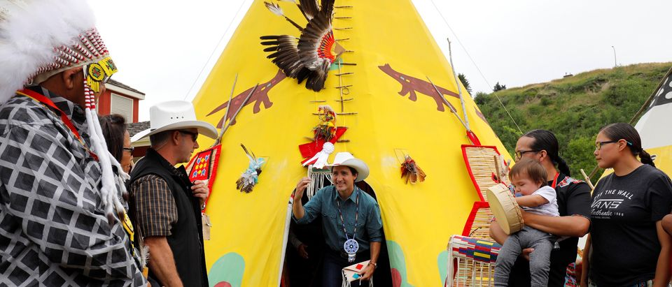 Canadian Prime Minister Trudeau comes out of a teepee at the Calgary Stampede in Calgary