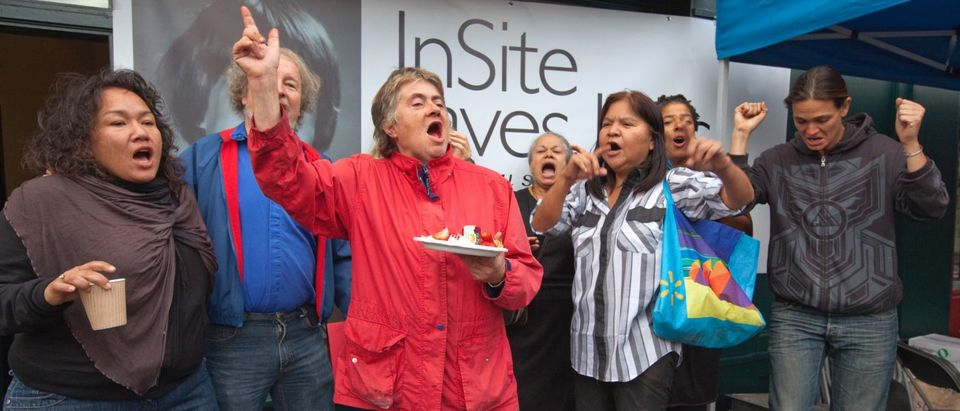 Workers at the InSite drug injection clinic celebrate decision from Supreme Court in Vancouver