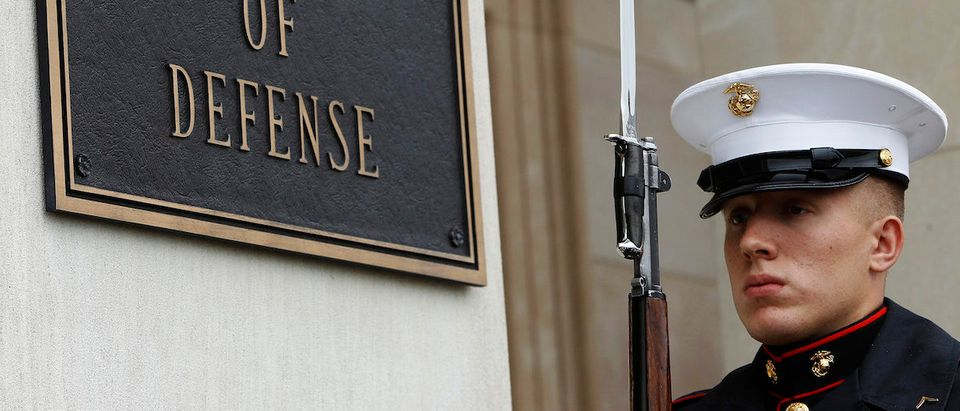 A U.S. Marine, who is part of a military honor guard, takes his position before a welcoming ceremony for German Defense Minister Thomas de Maiziere, by U.S. Defense Secretary Chuck Hagel, at the Pentagon in Washington April 30, 2013. (REUTERS/Gary Cameron)