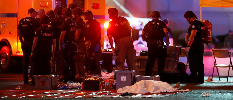 A body is covered with a sheet in the intersection of Tropicana Avenue and Las Vegas Boulevard South after a mass shooting at a music festival on the Las Vegas Strip in Las Vegas, Nevada, U.S. October 1, 2017. REUTERS/Las Vegas Sun/Steve Marcus