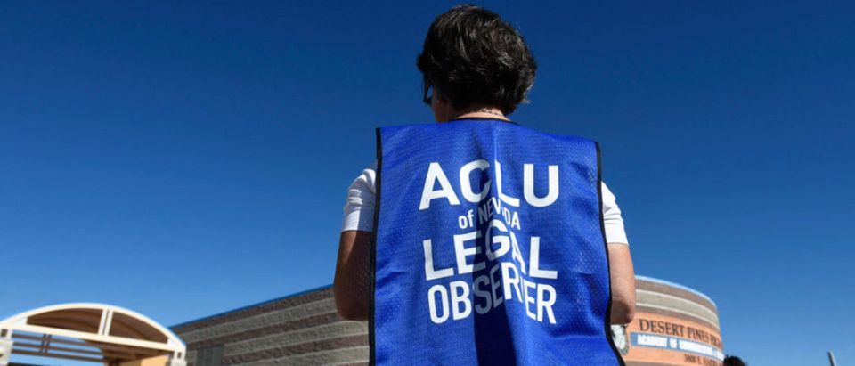A member of the ACLU observes a polling station during voting in the 2016 presidential election at Desert Pines High School in Las Vegas, Nevada, U.S Nov. 8, 2016. REUTERS/David Becker