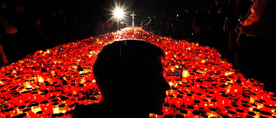 A young Croat boy burns candles to commemorate All Saints Day at the Mirogoj, Zagreb's main cemetery, November 1, 2010. Croatian Roman Catholics marked All Saints Day by visiting the graves of deceased relatives and friends. REUTERS/Nikola Solic