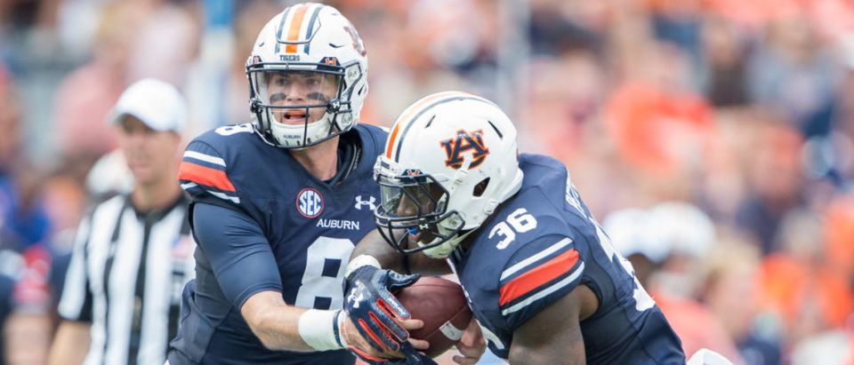 AUBURN, AL - SEPTEMBER 16: Quarterback Jarrett Stidham #8 of the Auburn Tigers hands the ball off to running back Kamryn Pettway #36 of the Auburn Tigers during their game against the Mercer Bears at Jordan-Hare Stadium on September 16, 2017 in Auburn, Alabama. (Photo by Michael Chang/Getty Images)