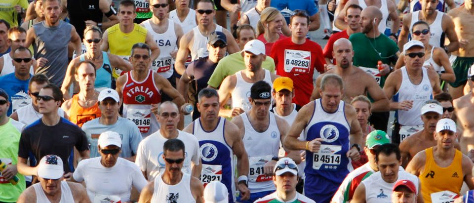 Runners participate in the annual Chicago Marathon October 10, 2010. The event, which has a 33-year history, involves up to 45,000 participants covering a distance of 26.2 miles (42 km), according to the event's website. REUTERS/John Gress