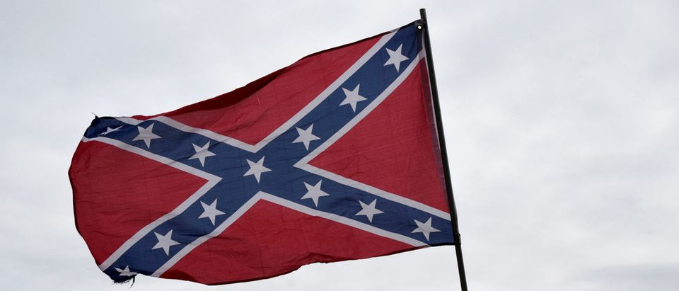 "Trevor Jackson displays a Confederate flag during a rally held by Sons of Confederate Veterans in Shawnee, Oklahoma, U.S. March 4, 2017. ""They are veterans and deserve to be honored,"" said Jackson. (Photo: REUTERS/Nick Oxford)"