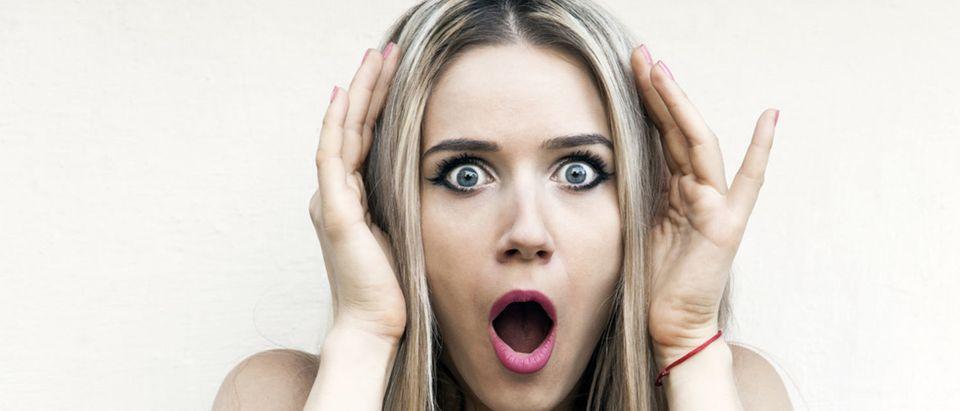 Confused, shocked girl (Shutterstock/LIUDMILA ERMOLENKO)