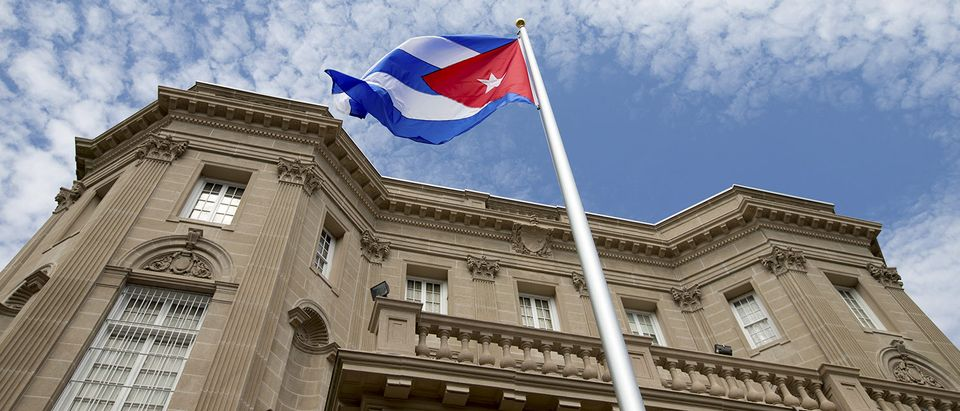 The Cuban national flag is seen raised over their new embassy in Washington
