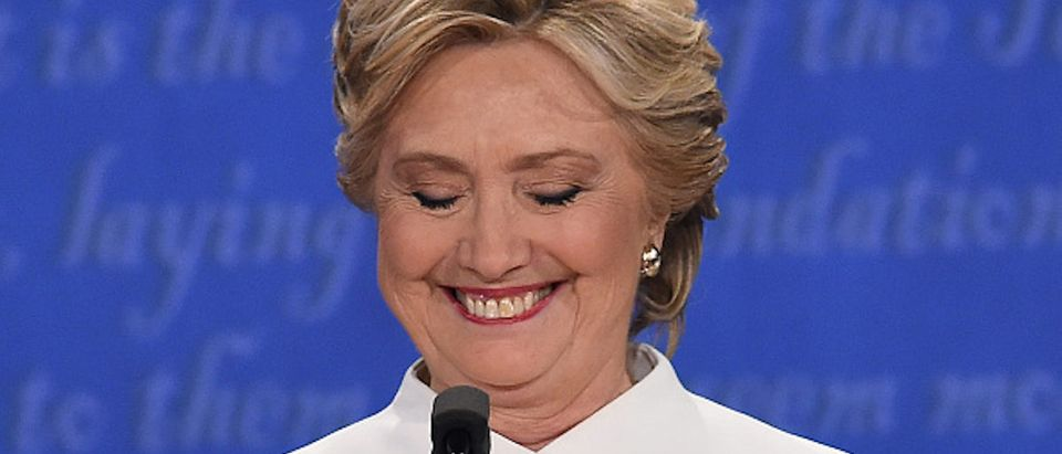 Democratic nominee Hillary Clinton smiles during the final presidential debate at the Thomas & Mack Center on the campus of the University of Las Vegas in Las Vegas, Nevada on October 19, 2016. / AFP / Robyn Beck (Photo credit should read ROBYN BECK/AFP/Getty Images)