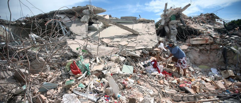 A woman looks through the rubble of a destroyed house after an earthquake, in Jojutla de Juarez, Mexico September 21, 2017. REUTERS/Edgard Garrido - RC133D3DBED0(Reuters)