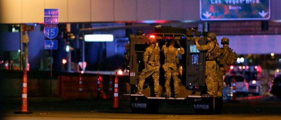 FBI agents ride an armored vehicle to a staging area on October 2, 2017, after a mass shooting during a music festival on the Las Vegas Strip in Las Vegas, Nevada, U.S. REUTERS/Las Vegas Sun/Steve Marcus