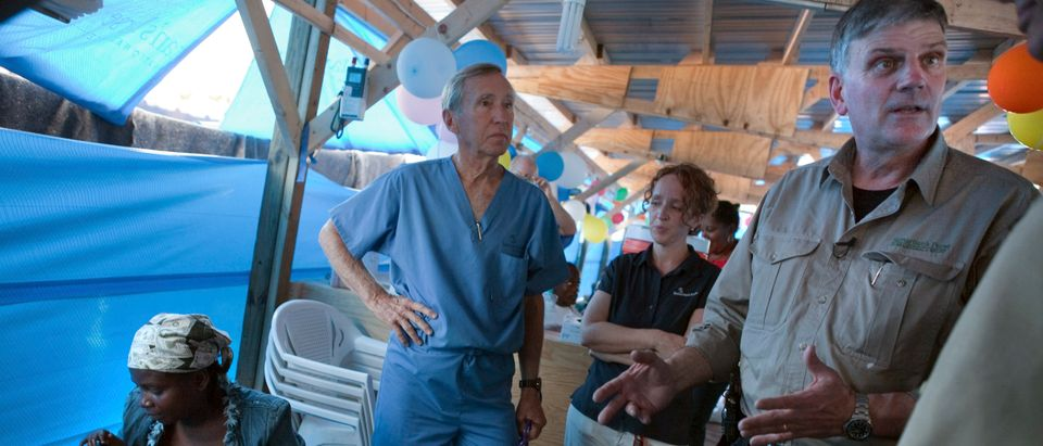 Graham, head of international relief organization Samaritan's Purse, visits one of the organization's cholera treatment centers in the Cite Soleil neighborhood of Port-au-Prince
