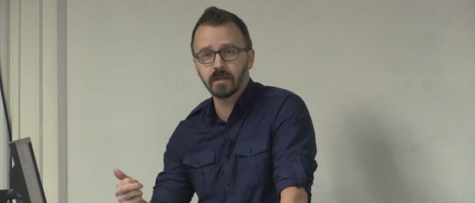 """George Ciccariello-Maher gives a lecture on """"decolonizing dialectics."""" (Photo Credit: YouTube/RowanCHSS)"""
