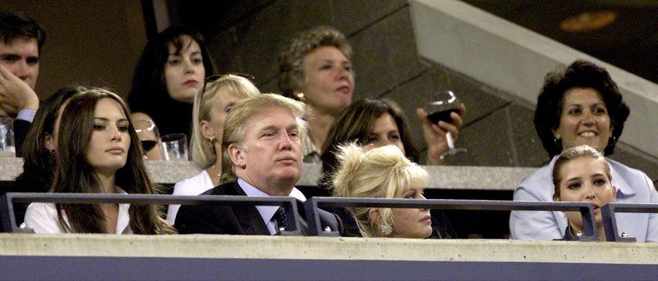 Real estate mogul Donald Trump watches Venus and Serena Williams compete during the women's final match of the US Open with his girlfriend Melania Knauss (L), his ex-wife Ivana Trump and their daughter Ivanka (R) September 8, 2001 at the USTA National Tennis Center in Flushing, NY. (Photo by Jamie Squire/Getty Images)