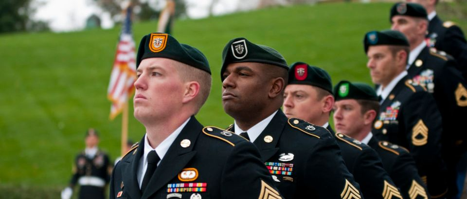 "Special Forces Green Beret soldiers from each of the Army's seven Special Forces Groups stand silent watch during the wreath-laying ceremony at the grave of President John F. Kennedy, Nov. 17, 2011, at Arlington National Cemetery. The ceremony marked a time-honored tradition to honor Kennedy for his support and advocacy of the soldiers who would be known simply as ""Green Berets."" (US Army/Flickr)"