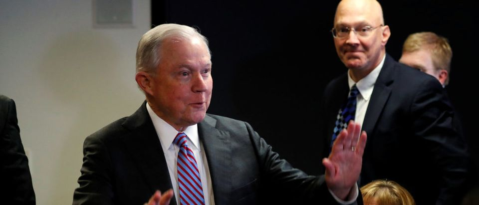 U.S. Attorney General Jeff Sessions is greeted by Department of Homeland Security staff members as he arrives for his remarks on the U.S. system for asylum-seekers at the Executive Office for Immigration Review in Falls Church, Virginia, U.S. October 12, 2017. REUTERS/Jonathan Ernst